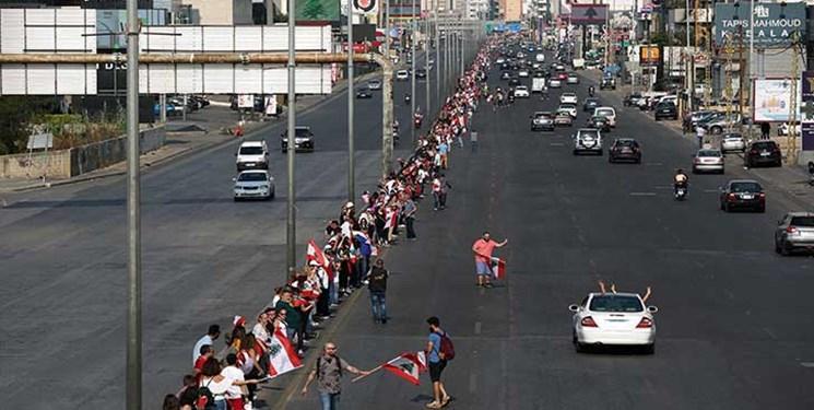 عکس و فیلم ، روز یازدهم تظاهرات لبنانی ها با تشکیل زنجیره انسانی 170 کیلومتری